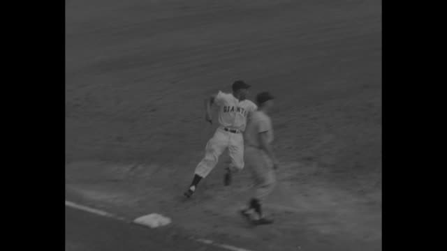 Second game of World Series 9/30/54 New York City aerial pan of Giants running onto the field at Polo Grounds cameras in fg / Giants' pitcher Johnny...