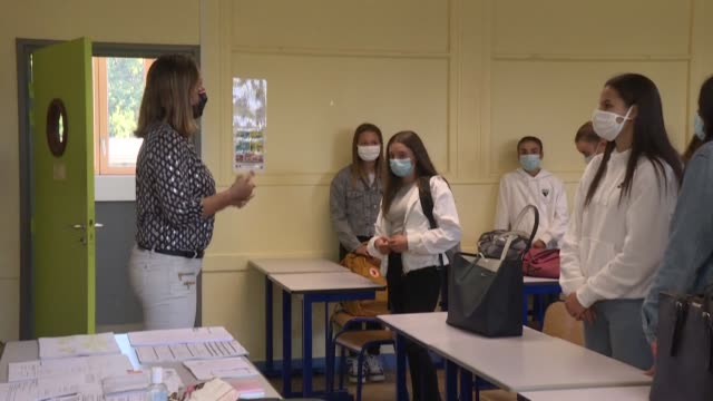 second grade students start school on tuesday morning at the lycée de bréquigny in rennes with staff and pupils both wearing masks in accordance with... - rennes france stock videos & royalty-free footage