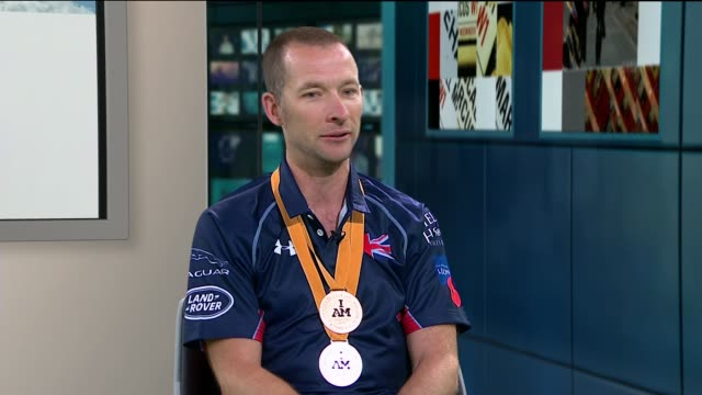 second invictus games: andy perrin wins gold medal in cycling event; england: london: gir: int andy perrin live interview sot - ニナ・ホサイン点の映像素材/bロール