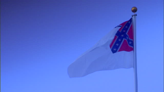 Second National Confederate States of America historic flag flying on flag pole American Civil War