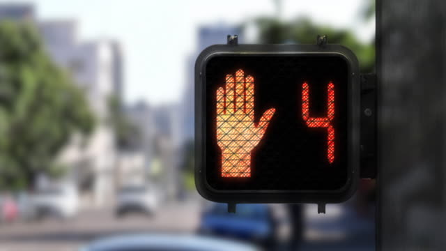 9 second red crosswalk countdown showing close up of walk signal - green light stock videos & royalty-free footage