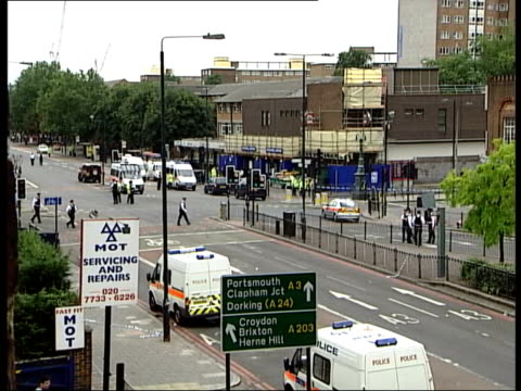 stockwell shooting england london stockwell ext group of police officers standing on street police vehicles outside stockwell tube station where... - stockwell stock videos and b-roll footage