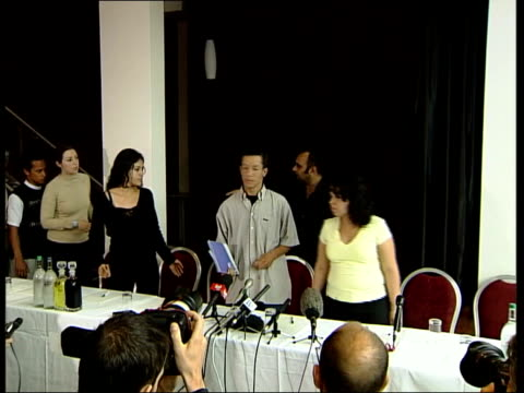 stockwell shooting family statement england london int tgv cousins of jean charles de menezes taking their seats at press conference cms cameraman... - ストックウェル点の映像素材/bロール