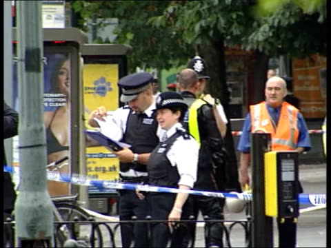 stockwell shooting police admit man was innocent stockwell police officers stood inside cordonedoff area policemen with holdalls entering station ls... - stockwell stock videos and b-roll footage