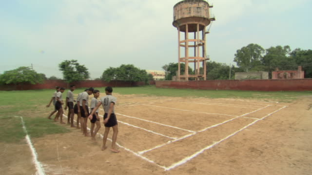 ws secondary school boys dressed in gym clothes lining up on sports field, districts of delhi, india - schoolboy stock videos and b-roll footage