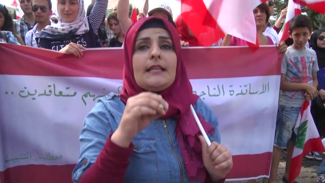 secondary schools teachers who passed the civil service council exams stage a protest on thursday at beirut's riad alsolh square calling on the... - information medium stock videos & royalty-free footage