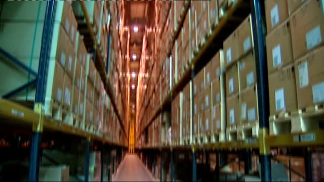 secret location: department of health warehouse: int boxes of tamiflu anti-viral medication stacked in warehouse packets of 75mg tamiflu capsules - warehouse点の映像素材/bロール