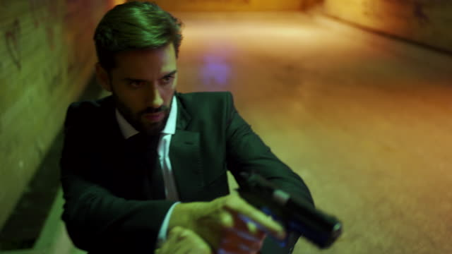 secret service agent on a criminal pursuit - assassination stock videos & royalty-free footage