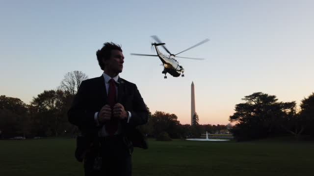 s secret service agent stands guard as marine one with us president donald trump onboard takes off on the south lawn of the white house on november 6... - secret service agent stock videos & royalty-free footage