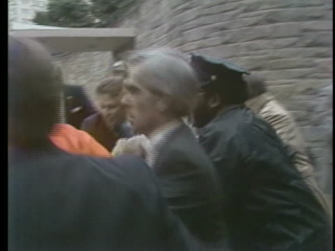 secret service agents rush to protect u.s. president ronald reagan during an assassination attempt by john hinckley, jr. - ronald reagan us president stock videos & royalty-free footage