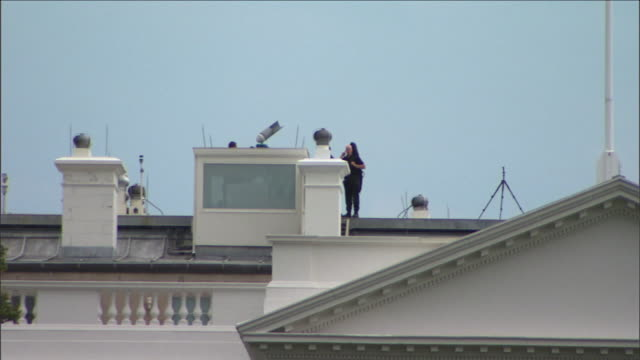 secret service agents stand guard on top of the white house roof in washington, d.c. - pediment stock videos & royalty-free footage