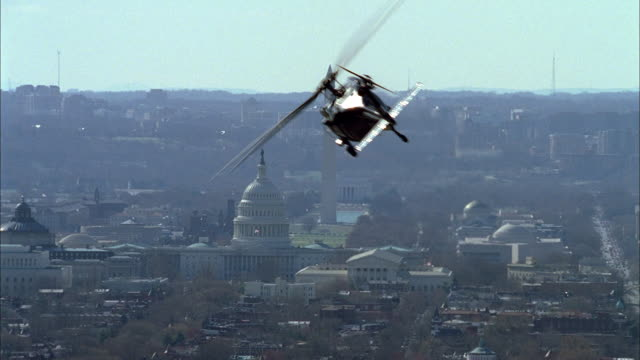 a secret service helicopter flies over capitol hill in washington, d.c. - obelisk stock videos & royalty-free footage