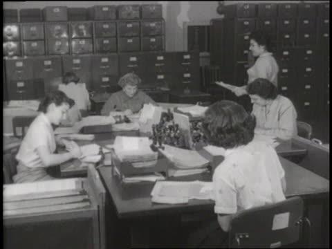 secretaries work in an office. - 1960 stock videos & royalty-free footage