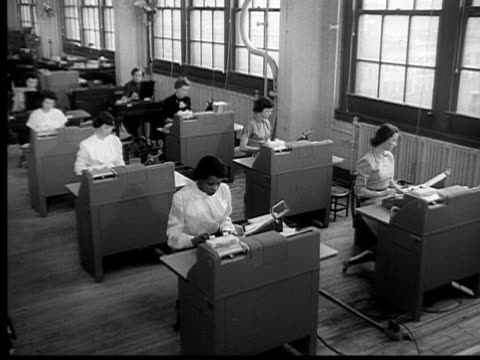 1954 b/w montage ha ws secretaries working in room / ms pan two women working at desks / usa - 1950 video stock e b–roll