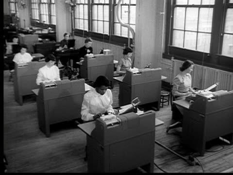 1954 B/W MONTAGE HA WS Secretaries working in room / MS PAN Two women working at desks / USA