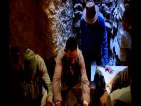 secretary general of egyptian supreme council of antiquities zahi hawass oversees opening of limestone sarcophagi 11 february 2009 - archaeologist stock videos & royalty-free footage