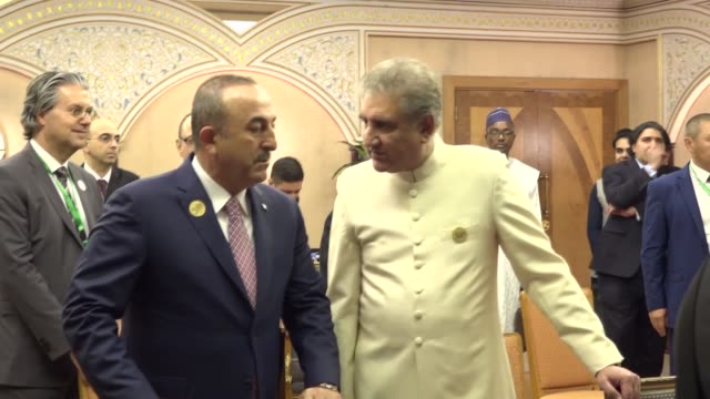 secretary general of the organization of islamic cooperation yousef al-othaimeen, turkish foreign minister mevlut cavusoglu and pakistani foreign... - jiddah stock-videos und b-roll-filmmaterial