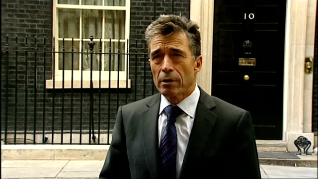 secretary general speaking to press after talks with david cameron; england: london: downing street: ext anders fogh rasmussen departing number 10... - secretary general stock videos & royalty-free footage