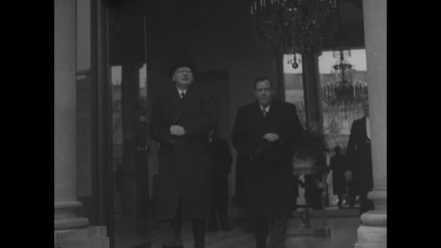 UN Secretary General Trygve Lie arrives at Elysee Palace and enters / He exits with Prime Minister Rene Pleven with both wearing overcoats and Pleven...