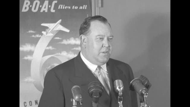 secretary general trygve lie stands in front of a boac poster and is directed by members of the press / sot lie says he would had hoped to have had a... - kennedy airport stock videos & royalty-free footage