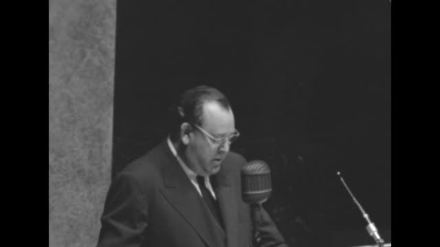 secretary general trygve lie wearing eyeglasses speaking behind microphone to general assembly welcoming them to new un building - paramount building stock videos and b-roll footage