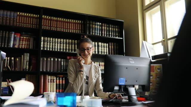 secretary having phone call - lip ring stock videos and b-roll footage