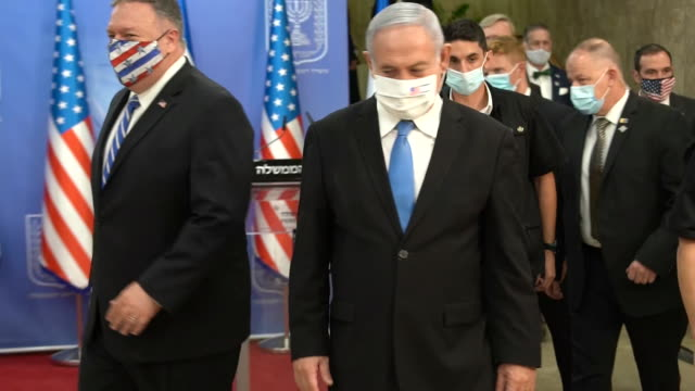 secretary mike pompeo bumps elbows with prime minister benjamin netanyahu after a joint press conference in israel. - healthcare and medicine or illness or food and drink or fitness or exercise or wellbeing stock videos & royalty-free footage