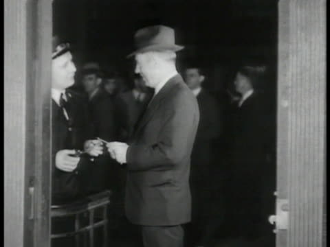 vídeos de stock e filmes b-roll de secretary of agriculture henry a wallace giving usher ticket at theatre nra director donlad richberg in office w/ unidentified associates secretary... - 1935
