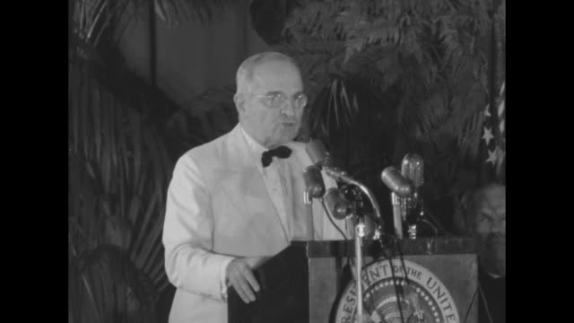 secretary of defense george marshall stands at podium at the armed forces day dinner in front of applauding audience and introduces president harry... - harry truman stock videos & royalty-free footage
