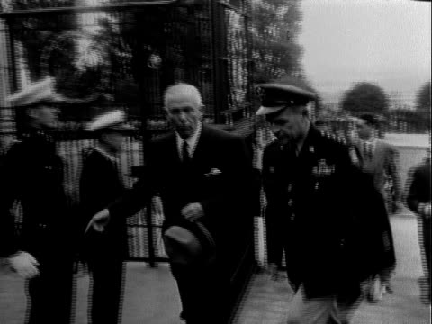 vídeos de stock, filmes e b-roll de secretary of defense george marshall walking with us army general matthew b ridgway , passing through wrought iron gate, general ridgway saluting us... - 1951