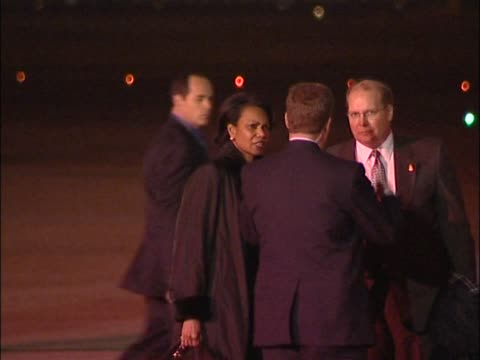 stockvideo's en b-roll-footage met us secretary of state condoleezza rice chats on the heathrow tarmac near air force one at the start of state visit by president george w bush - start en landingsbaan