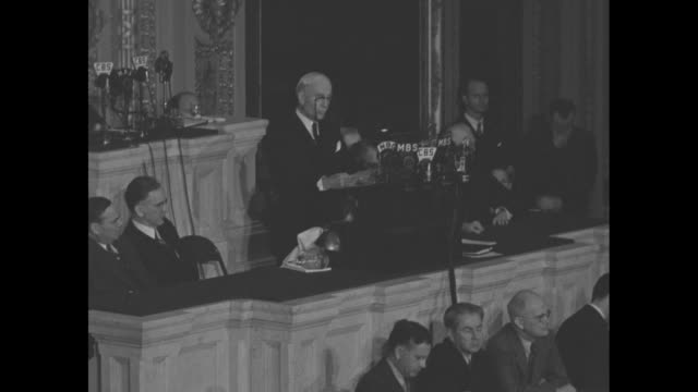 secretary of state cordell hull stands before bank of radio microphones as he addresses a joint session of congress about his attendance at the third... - joint session of congress stock videos and b-roll footage