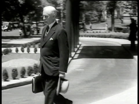 vídeos de stock e filmes b-roll de secretary of state cordell hull walking on driveway hull seated saying primary police of foreign policy is promotion maintenance of peace - 1935
