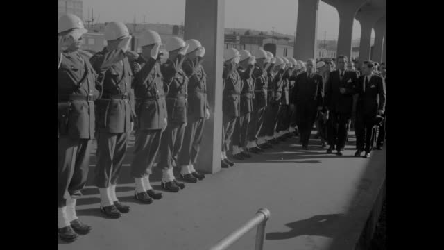 secretary of state edward stettinius deplanes from usaaf plane shakes hands with men greeting him on tarmac / mls stettinius and others walk toward... - 1945 stock-videos und b-roll-filmmaterial
