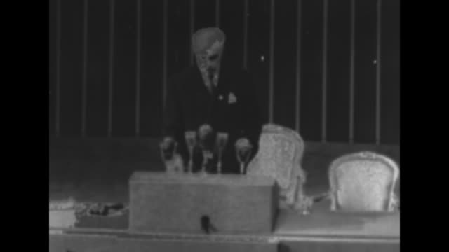 Secretary of State Edward Stettinius Jr standing at podium in War Memorial Opera House as he addresses delegates at the Second UN Conference SOT...