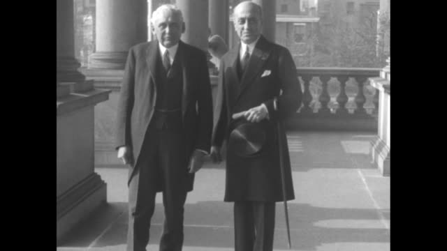 vídeos de stock, filmes e b-roll de secretary of state frank b kellogg and turkish ambassador muhtar bey holding top hat and cane on arm together on porch / cu bey / note exact... - atlântico central eua