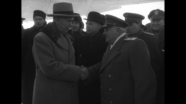 US Secretary of State George Marshall coming down steps from plane / Marshall shaking hands with Russian Deputy Foreign Minister Andrey Vyshinsky /...