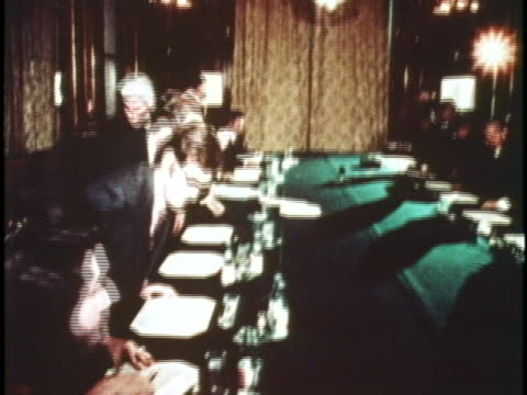 secretary of state henry kissinger and le duc tho shake hands at a cease fire negotiation during the paris peace accords. - ceasefire stock videos & royalty-free footage
