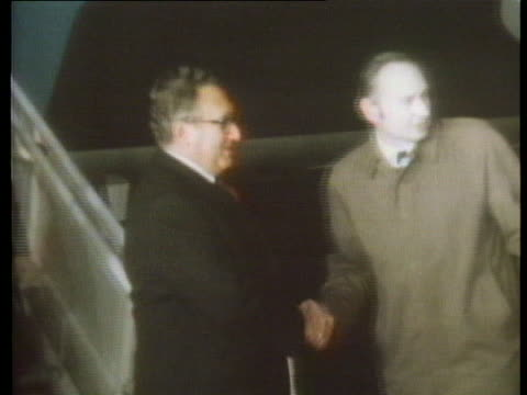 secretary of state henry kissinger arrives in london to meet with british prime minister harold wilson. - (war or terrorism or election or government or illness or news event or speech or politics or politician or conflict or military or extreme weather or business or economy) and not usa stock videos & royalty-free footage