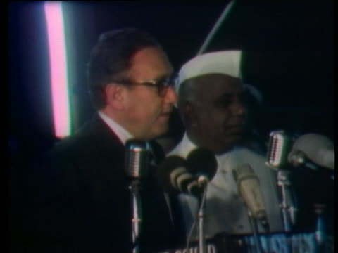 secretary of state henry kissinger comments on the opportunity for international peace after arriving in new delhi, india. - (war or terrorism or election or government or illness or news event or speech or politics or politician or conflict or military or extreme weather or business or economy) and not usa stock videos & royalty-free footage