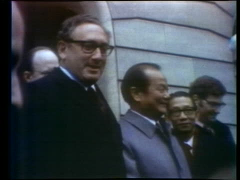 secretary of state henry kissinger shakes hands with south vietnamese representative tran van lam after reaching a ceasefire agreement at the paris... - (war or terrorism or election or government or illness or news event or speech or politics or politician or conflict or military or extreme weather or business or economy) and not usa video stock e b–roll
