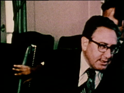 US Secretary of State Henry Kissinger talks to US Republican President Gerald Ford