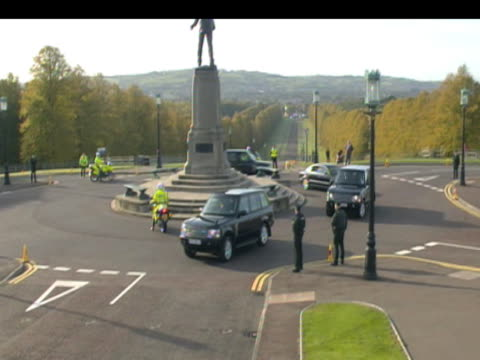 us secretary of state hillary clinton arrives at stormont castle by motorcade during trip to northern ireland 12 october 2009 - stormont stock videos and b-roll footage