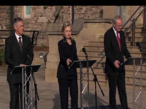 us secretary of state hillary clinton emerges from stormont castle with first minister peter robinson and deputy first minister martin mcguinnesson... - stormont stock videos and b-roll footage
