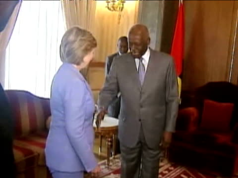 US Secretary of State Hillary Clinton is greeted by Kenyan President Mwai Kibaki I during 11 day tour of Africa 5 August 2009