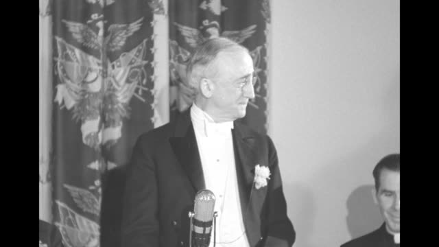 secretary of state james f byrnes with priest fulton sheen at lower right during al smith memorial dinner in new york city on 8/16/1946 // 3/15/1946... - waldorf astoria stock videos & royalty-free footage
