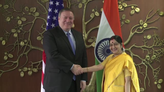 US Secretary of State Mike Pompeo shakes hands with his Indian counterpart Sushma Swaraj in the Indian capital where he is due to hold talks on a...