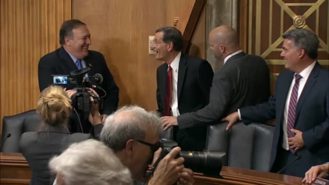 secretary of state mike pompeo shakes hands with senators prior to a hearing of the senate foreign relations committee takes his seat senator bob... - membro del congresso video stock e b–roll