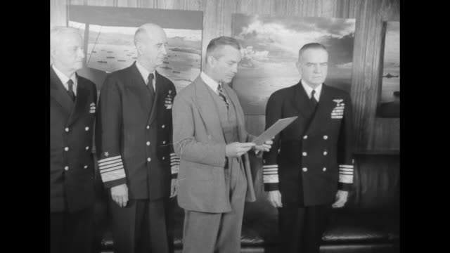 us secretary of the navy james forrestal reads document at ceremony at which us third fleet commander admiral william bull halsey is promoted to... - william halsey stock-videos und b-roll-filmmaterial
