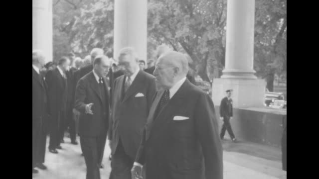 us secretary of war henry stimson and his wife mabel walk to entrance of white house as they arrive for memorial service for pres franklin roosevelt... - 長点の映像素材/bロール